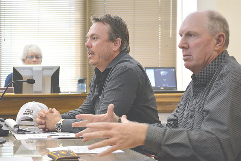 Josh Allison (at left) and Randy Greer (at right) of 307 Horse Racing pitch Park County commissioners on the benefits of bringing pari-mutuel betting into the county. Commissioners agreed to put a question on November's general election ballot that, if approved by voters, would allow the practice in Park County.