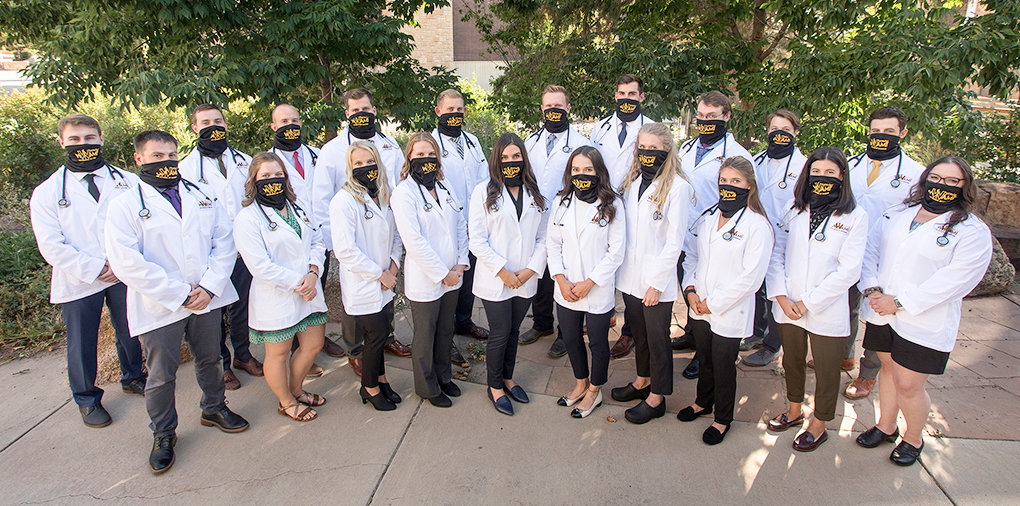 Members of the new WWAMI Medical Education Program at UW are (front row, from left): Cade Budak, Audrey Lucas, Holly Huber, Ariel Rap, Taylor Thompson of Cody, Luiza Bosch, Madeleine Isler, Sierra Levene, Grace Nicholas of Cody and Rikki Nelson. Pictured in the back row (from left) are Joseph Keating, Bryce Snow, Blake Hopkin of Powell, Austin Ellis of Byron, Maison Furley, Bret Andrew, Drew Adriaens, Dane Patey, Cody Abbott and Jackson McCue.