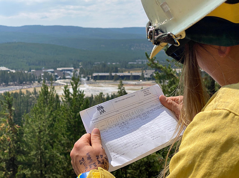 A Fire Effects monitor records weather data from a vantage point on Geyser Hill in the Old Faithful area, approximately 3 miles northwest of the Lone Star Fire.