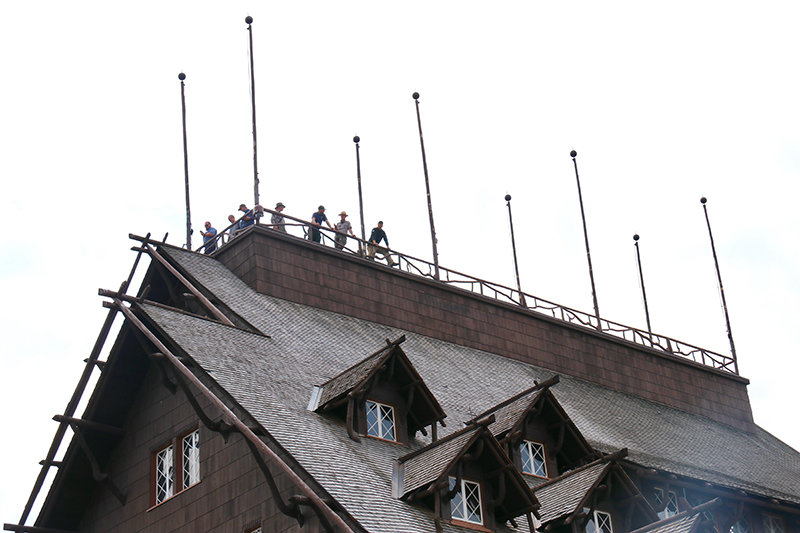 Fire personnel stand with park staff and concessionaires on the roof of the Old Faithful Inn during a sprinkler system test on Aug. 25.