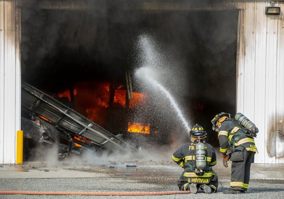 Multiple buses suffered severe damage in Monday's fire, which was reported around 9:40 a.m.