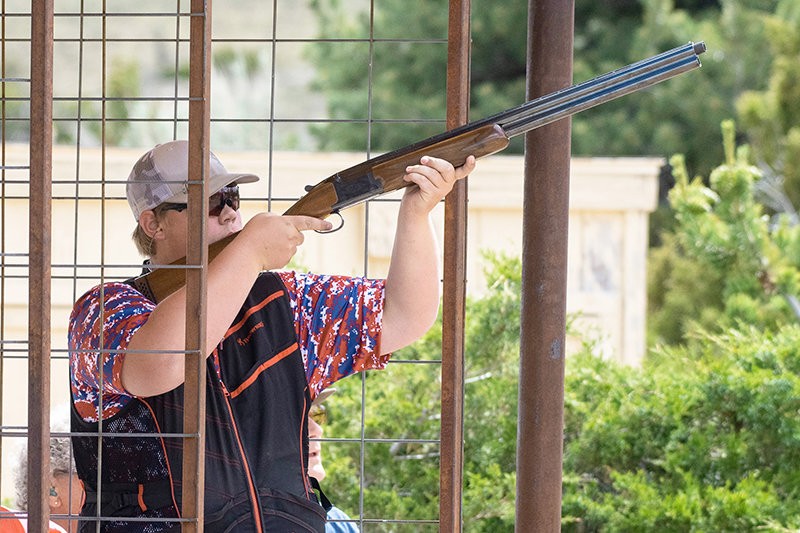Jace Nordeen, a Powell High School student, shoots for Powell's Polestar Outdoors competition sporting clays team during the Cody Round-Up Regional Shoot in June. Nordeen is one of the top shooters in his class in the state.
