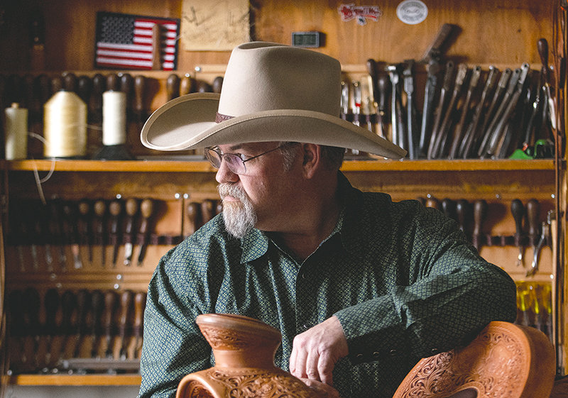 Keith Seidel, owner of Seidel's Saddlery and director of the Scout Saddle Company at the Buffalo Bill Center of the West, sits in his shop in downtown Cody. Seidel is mentoring three apprentices at the museum's saddle shop.
