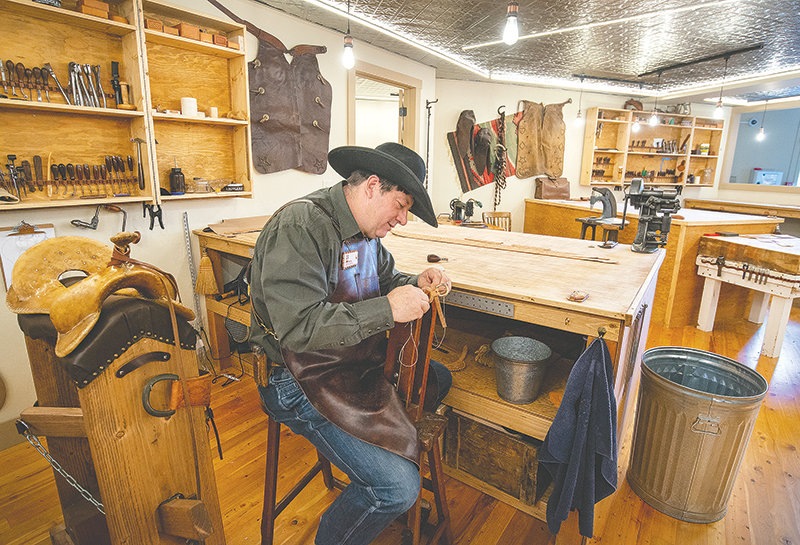 Mark Barcus works on a project in the Scout Saddle Company while working on a five-year apprenticeship.