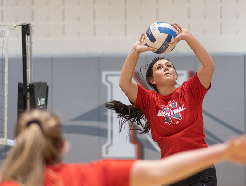 NWC sophomore Grace Trandahl sets the ball in the Trappers' practice on Monday. Trandahl and Emily Baumstarck were members of last year's Sheridan squad that won four conference matches.