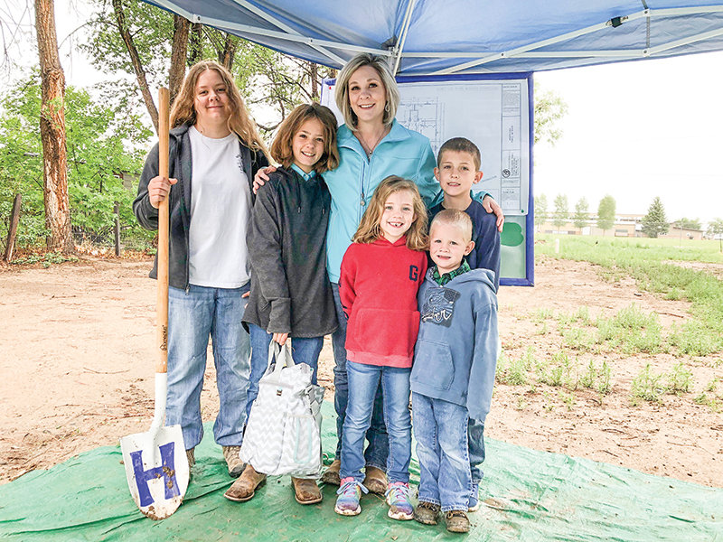 The homeowner, Beth Jolley, is pictured with five of her seven kids (from left): Danica, Tayla, Brooklyn, Hunter (front) and Garrett.