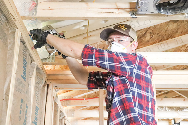 Elder Talmage Carter from Elsinore, Utah, with the Church of Jesus Christ of Latter-day Saints, works on the house.