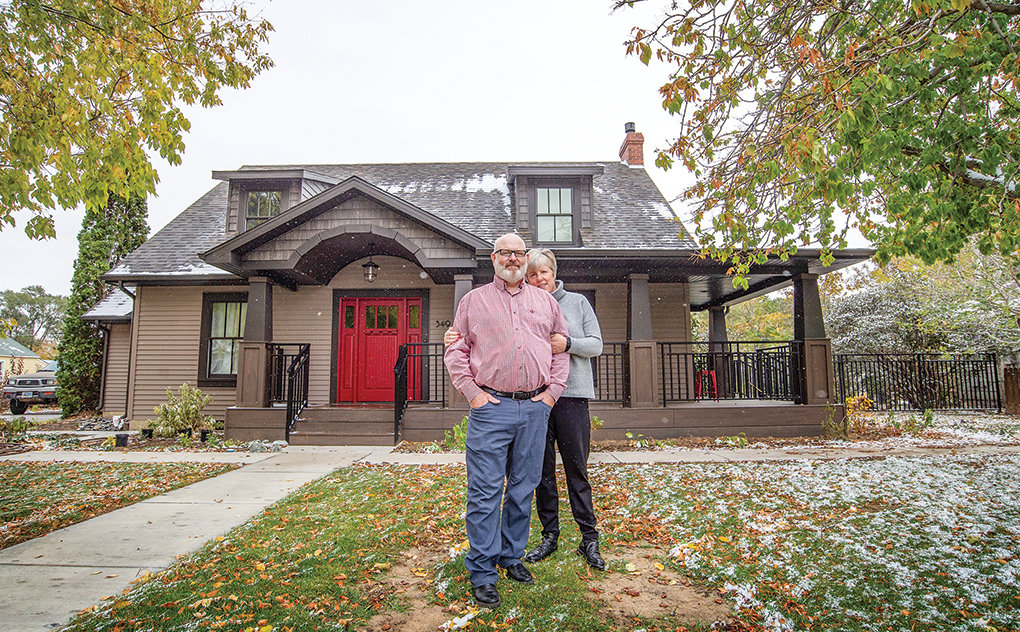 Steve and Meg Nickles pose in front of their recently refurbished home on Douglas Street in Powell. The couple decided to do a complete makeover instead of building new because they love the neighborhood and the 1940s home.