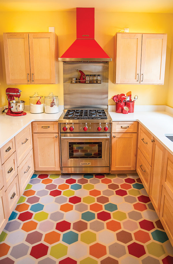 The new kitchen is colorful and vibrant. Changes in the house allowed for a more open kitchen layout, including a second sink and for a special stand-alone icemaker, 'one of the few extravagances' the couple ordered to make the home their own.
