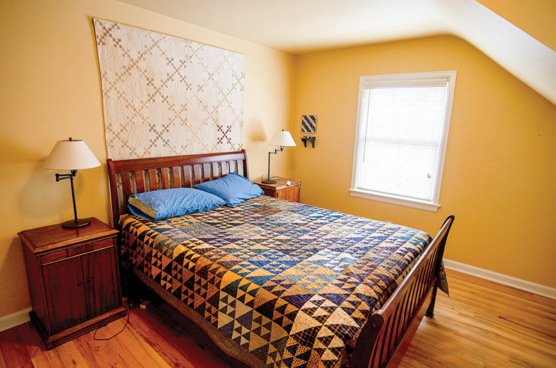 The guest bedroom shows off Meg Nickles' passion for quilting. Much of the basement is dedicated to her quilt craftwork.