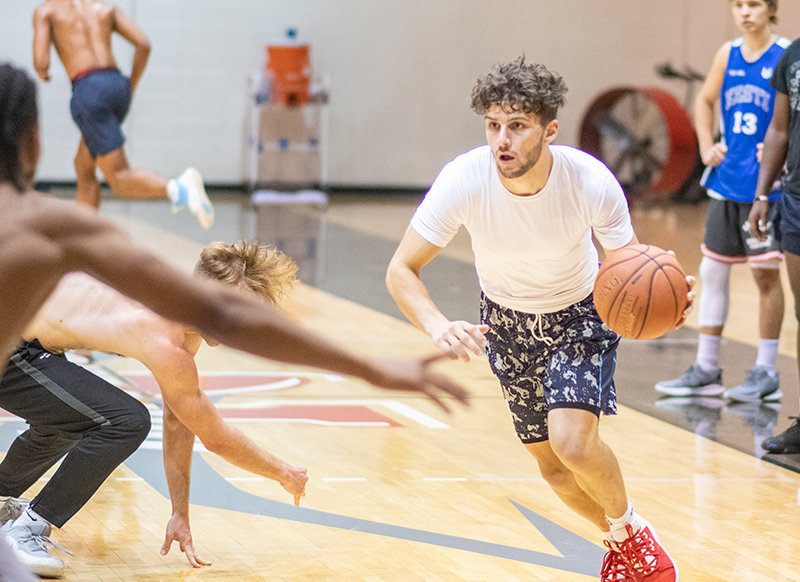 Jaren Fritz drives from the wing at a Northwest College basketball practice on Tuesday, Oct. 13. The Sheridan transfer spends much of his time in the studio when not hooping.