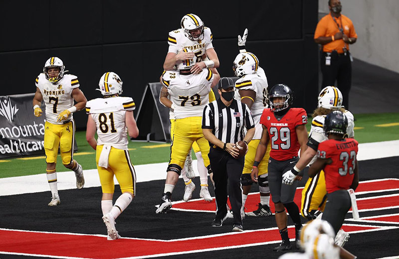 University of Wyoming freshman Levi Williams celebrates in the UNLV end zone after scoring one of his three rushing touchdowns on Friday. The Pokes blew out the Rebels, 45-14.