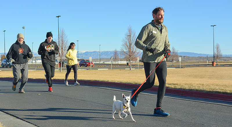 Humans and canines alike, including Tim Baxter and his pup, got up on Thanksgiving morning for the annual Turkey Trot, which serves as a benefit for the Powell High School Robotics Club. Organizers were pleased with the turnout in this COVID-19-disrupted year.