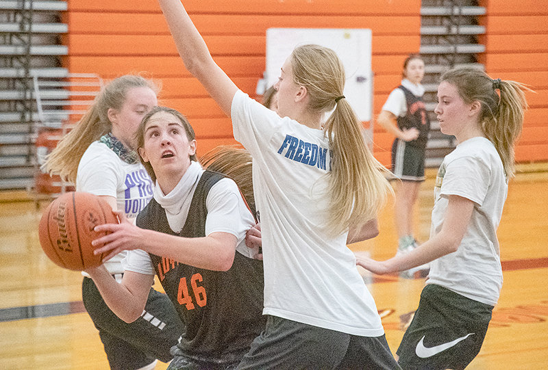 Sophomore Megan Jacobsen goes for a contested shot on Tuesday in practice. The Panthers are hoping their work over the summer translates to an improved team in 2020-21.