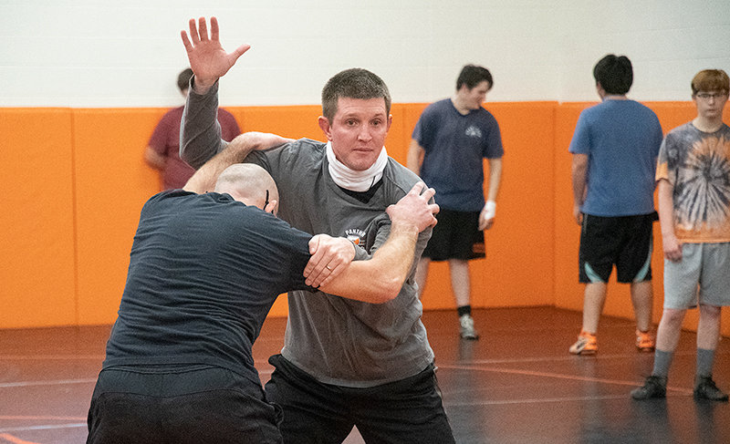 PHS wrestling coach Nick Fulton teaches a technique to his athletes at a recent practice. Fulton is in his first season as head coach after serving as an assistant for several years.