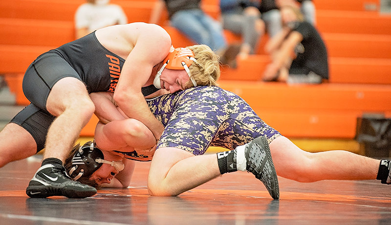 Lannon Brazelton wrestles against Campbell County's Cohen Granzer Friday at the Powell Dual Invite. Brazelton pinned Granzer in 2:26.