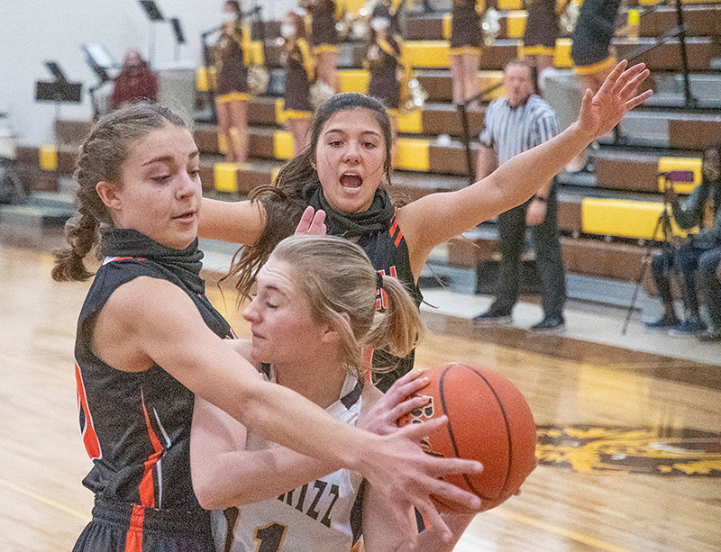 Anna Bartholomew and Kaili Wisniewski trap a Rocky Mountain player in Saturday's 29-19 loss to the Grizzlies. The PHS JV will look to return to .500 on Friday against Shoshoni.