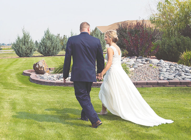 Clay and Lisa Lynn walk together during their August wedding at Joy Bessler's property west of Powell. Bessler can cater weddings across the area, but also offers her own home as a venue.