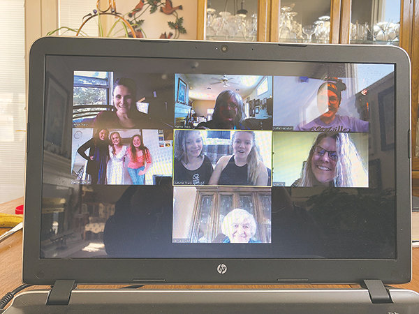 This screen shot from wedding dress selection day captured participants on Zoom. Bride Amanda Tracy was in her Laramie apartment with her roommates for a two-hour modeling session.