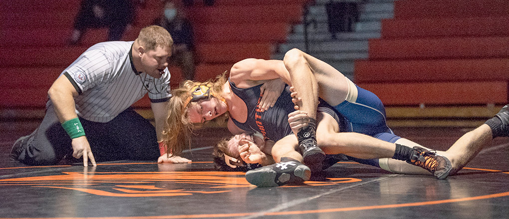 PHS wrestler Mikey Timmons, on top, competes against Cody's Gavin Vance on Tuesday, Jan. 12. The Panthers went 4-2 in their most recent stretch of events, defeating Lovell, Cody, Mountain View and Rawlins.