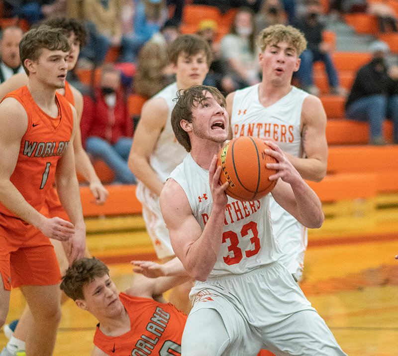 PHS senior Adrian Geller secures a loose ball Saturday in the Panthers' upset win over Worland. Geller's presence down low was a huge factor in breaking out to an early lead, according to coach Mike Heny.