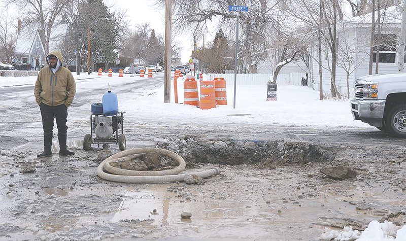City crews had to dig a hole in Avenue E to reach a water main that broke early Wednesday morning. Levi Kary, Powell Water Department technician, is pictured at left.