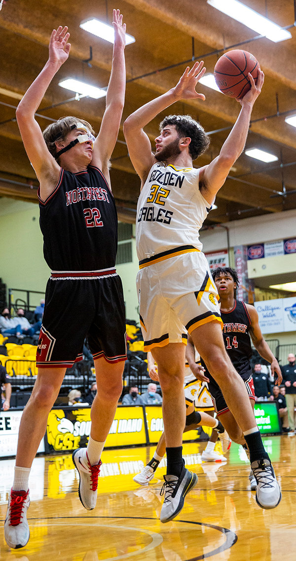 Northwest College guard Andre Loigu attempts to block College of Southern Idaho's Tsotne Tsartsidze in a game earlier this season. On their third weekend of the season, the Trappers won two games in Scottsbluff, Nebraska.