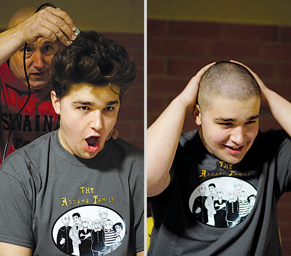 """Jared Knaub reacts to having his head shaved by his father, Mike, as part of a fundraiser. Knaub is Uncle Fester in """"The Addams Family"""" MAHS musical."""