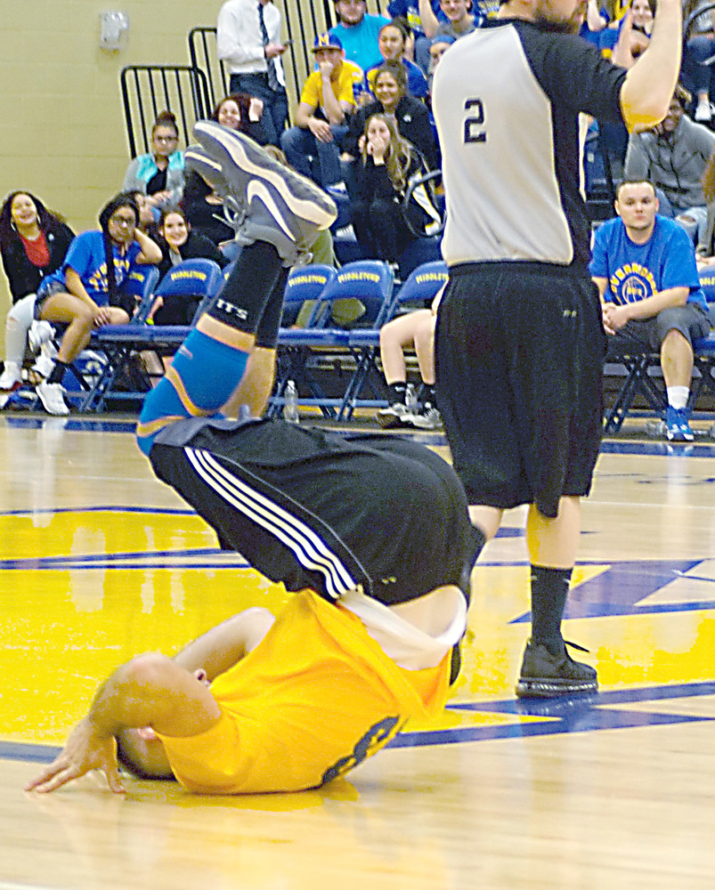 Veto team member Adam Tankersly recovers from a foul during the game