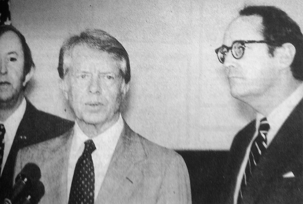 President Jimmy Carter flew to Three Mile Island to investigate the situation. Following his tour of the nuclear reactor, Carter held a news conference  in the Middletown Community Building to reassure the area residents of the actions being taken by Met-Ed, and state and federal government. To the right is Gov. Dick Thornburgh.