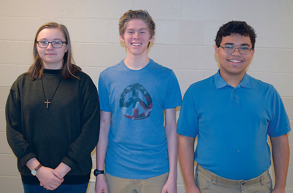 Katelyn Truesdell, Ryan Pumo and Ian Bruce qualified for the PMEA District Band festival in February.