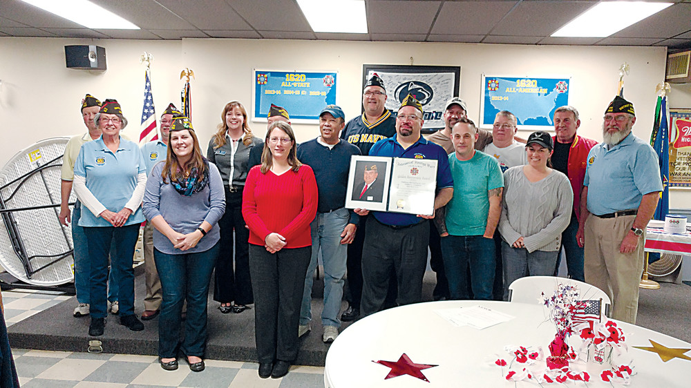 Members of VFW Post 1620 pose with the certificate commemorating their 50 years of dedication to all veterans.