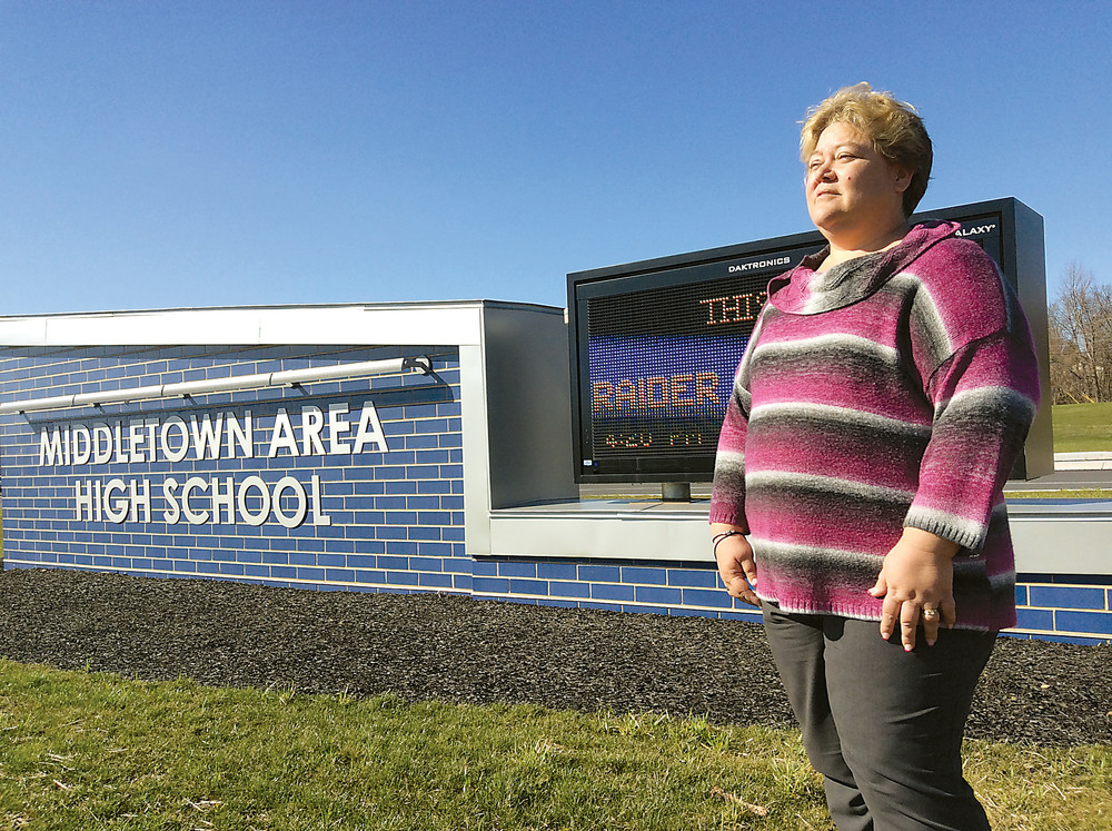 Dawn Knull stands in front of the Middletown Area High School campus. She is leading an effort to change state law to restrict where some sex offenders may live after being released.