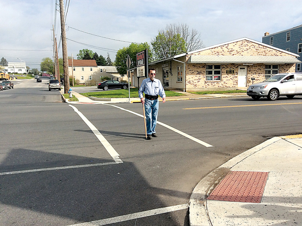 Leonard Dobson Jr. of Londonderry Township crosses Main Street in the crosswalk at Main and Spruce in this April 2017 file photo.