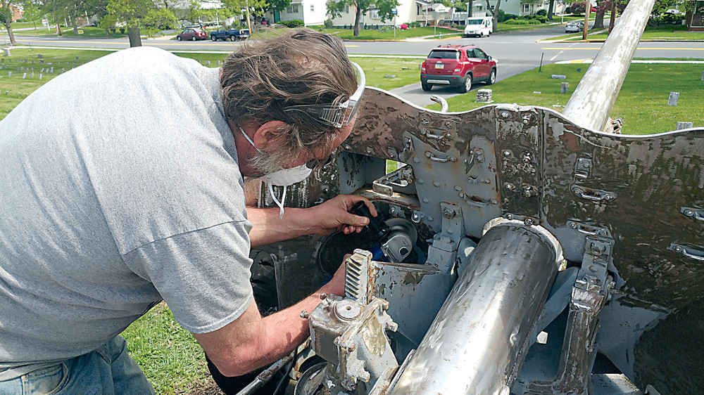 Tom Menear of the Middletown Sons of American Legion works on renovating cannons last Thursday at Middletown Cemetery.