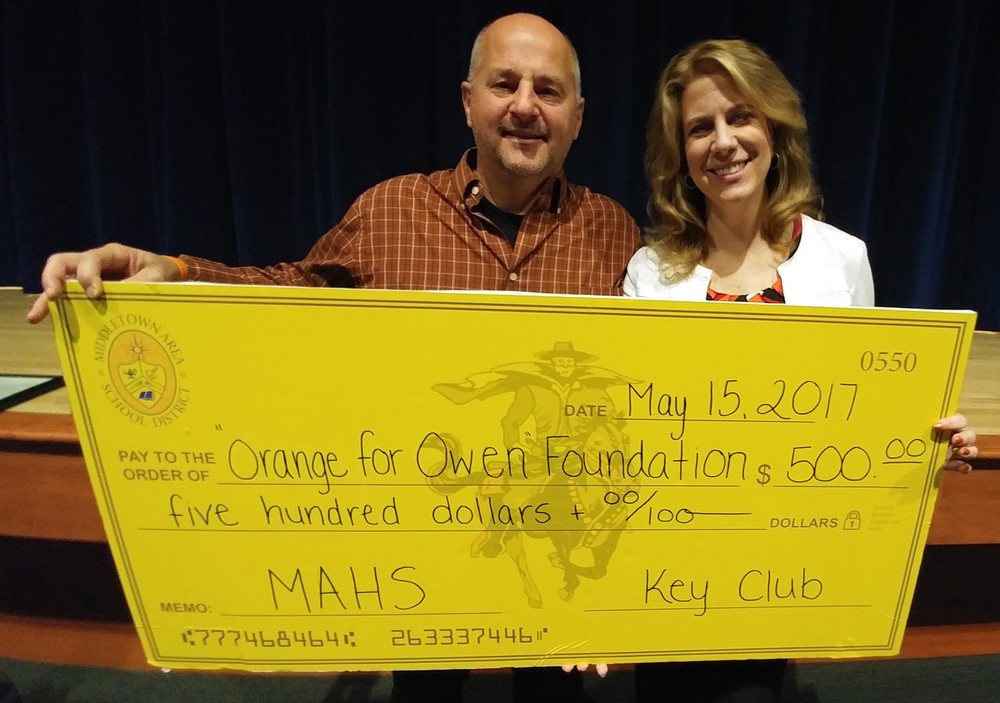 Mark and Karen Brezitski are trying to honor the memory of their son, Owen, who lost his life in March 2011, when he was struck by a distracted driver. The MAHS Key Club donated $500 to their foundation, Orange for Owen.