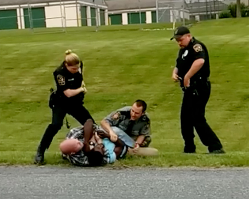 Police officers subdue a Harrisburg man during an incident on Vine Street, Londonderry Township. on Wednesday, May 24.
