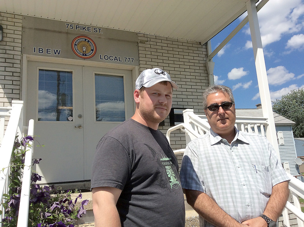 John Levengood, right, president of IBEW Local Union 777, stands in front of the union local on Pike Street in Middletown on June 1 with Nate Grove, a union member and one of the nearly 300 full-time employees who work at Three Mile Island who are represented by the local.