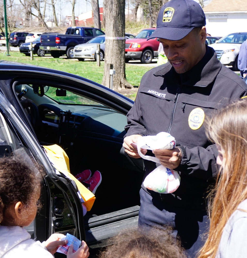 Police Chief George Mouchette hands out stickers to  children that attended the police Easter egg hunt in April at Hoffer Park.