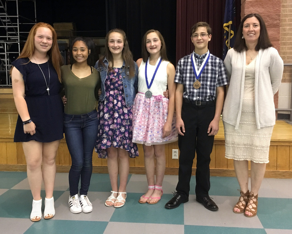 Lower Dauphin Middle School seventh-grader Hayden Milic, second from the right, was the winner of the Optimist Oratorical Contest Tuesday, May 2, and attended the zone competition in Reading on May 6. The school's runner-up was Larissa Goodman, third from right. Other students competing at the middle school were, from left, Sarah Hanula, Abigail Perez and Gabrielle Goodman. On the right is seventh-grade English teacher Diane Giuliano.