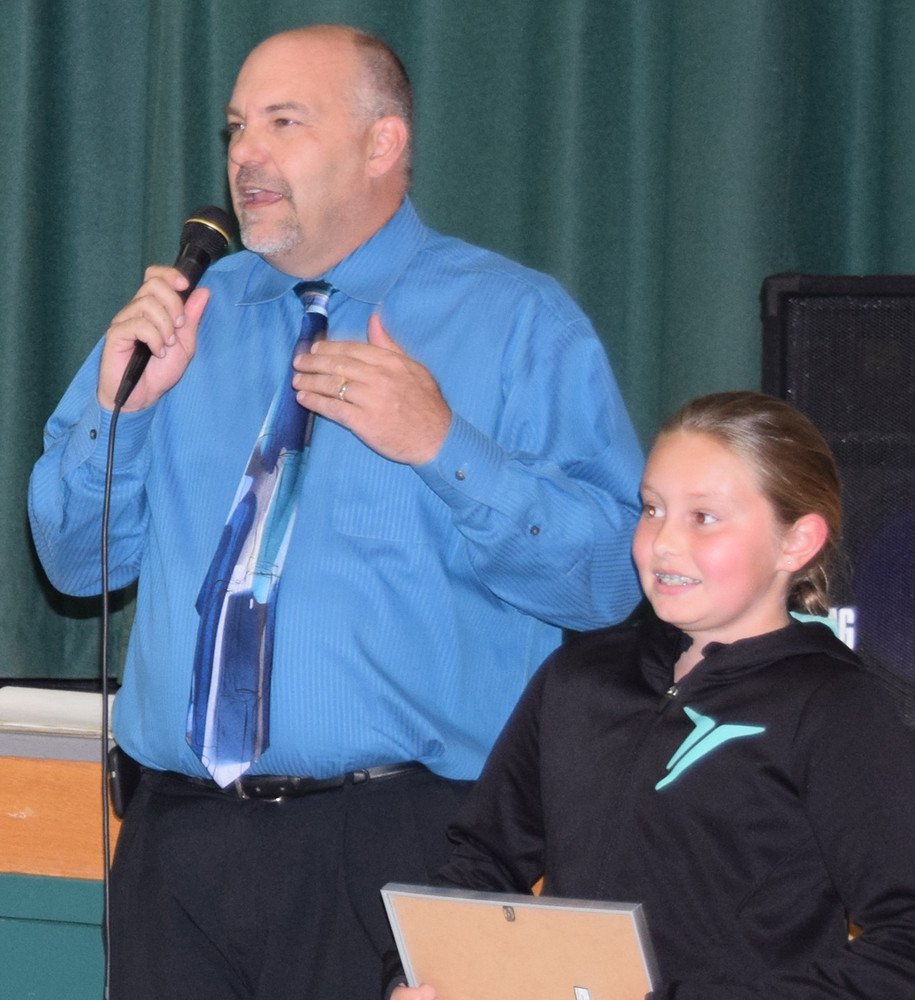 East Hanover Elementary School Principal Gary Messinger tells Sara Reichelderfer's classmates about her actions for which she was recognized by winning the Do the Right Thing award.