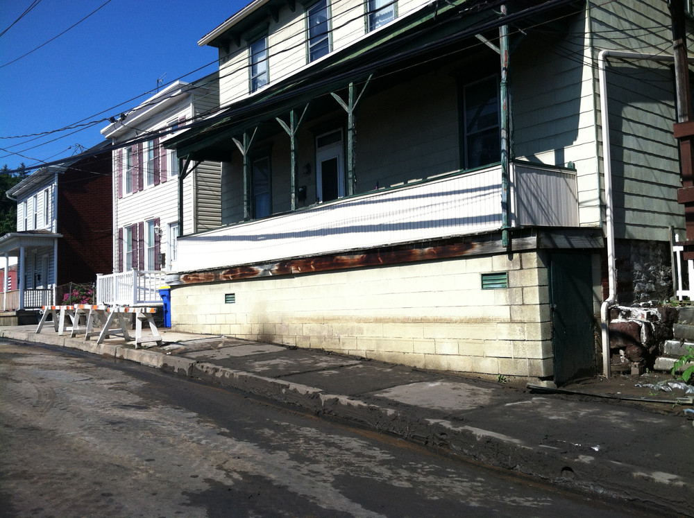 A water mark on this house shows how high the water got just south of the Wood Street underpass in late July.