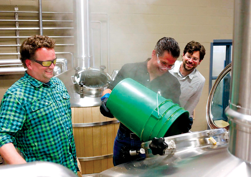 From left, John Trogner, Troegs co-owner; Rep. Tom Mehaffie; and Chris Trogner, Troegs, co-owner, take part in the Brewer For A Day event held at Troegs Independent Brewing in Hershey on July 17