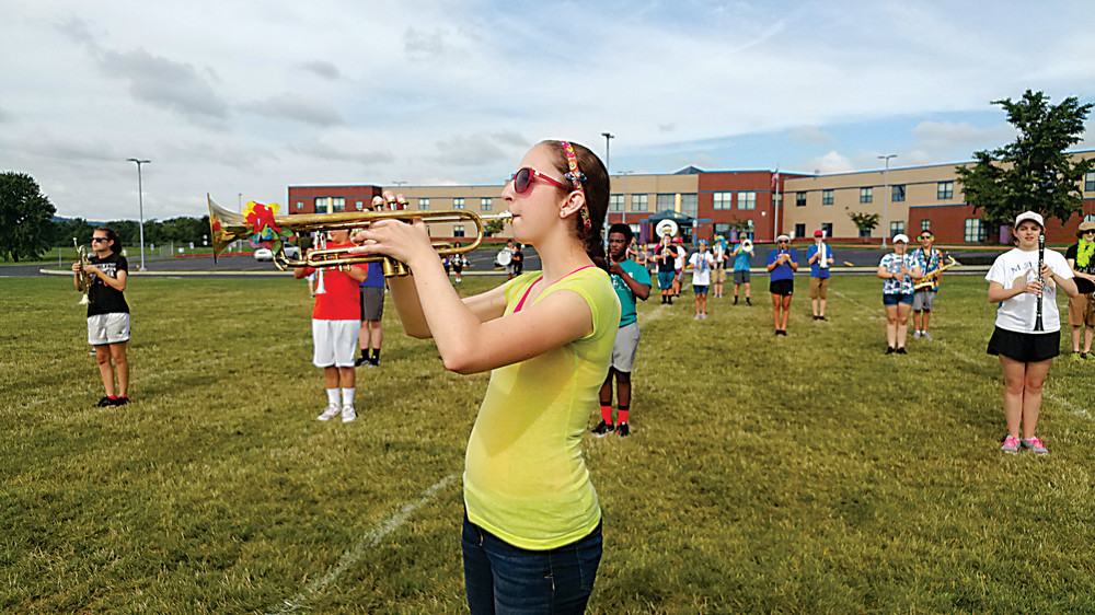 Sophomore trumpet player Megan Burghdorf works on a solo during band camp on Aug. 8.