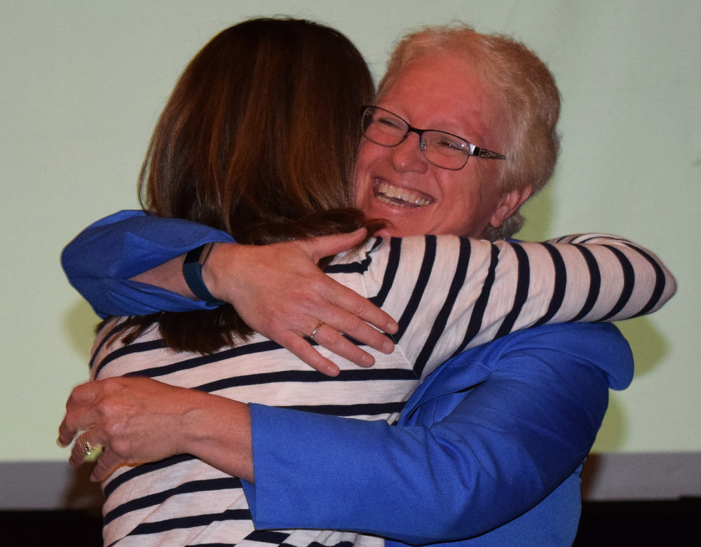 Superintendent Sherri Smith, right, hugs Middle School Spanish teacher Anne Masorti, who recently received a pin for 20 years of service in the Lower Dauphin School District.