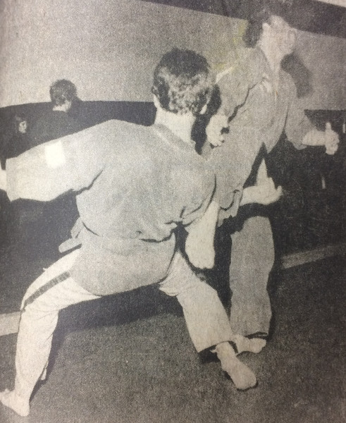 "IT'S ALL A MATTER OF DISCIPLINE — Some of the students enrolled in Roger Engle's current karate classes work on their techniques during recent sessions in the wrestling room at Elizabethtown's Middle School. Dave Underwood parries Tom McAndrews' attempted kick with a lightning arm blow that appears to be causing' McAndrews a certain amount of discomfort. Although the current course in Korean style ""Moo-Duk-Kwon"" karate will end next Friday, the Elizabethtown Area Recreation Commission will be sponsoring three more classes between now and Christmas, all of them to be taught by Engle."