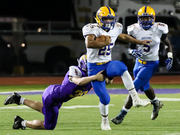 Jose Lopez tries to high-step out of a Boiling Springs tackle.