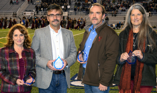 """Patti Krow, Tim Bartholomew, Kurt Stoner and Sally Zaino received awards from the LD Alumni Association at halftime of the Lower Dauphin Homecoming game vs Bishop McDevitt on Oct. 27. Not pictured is Dr. Kirk """"Wade"""" Seibert."""