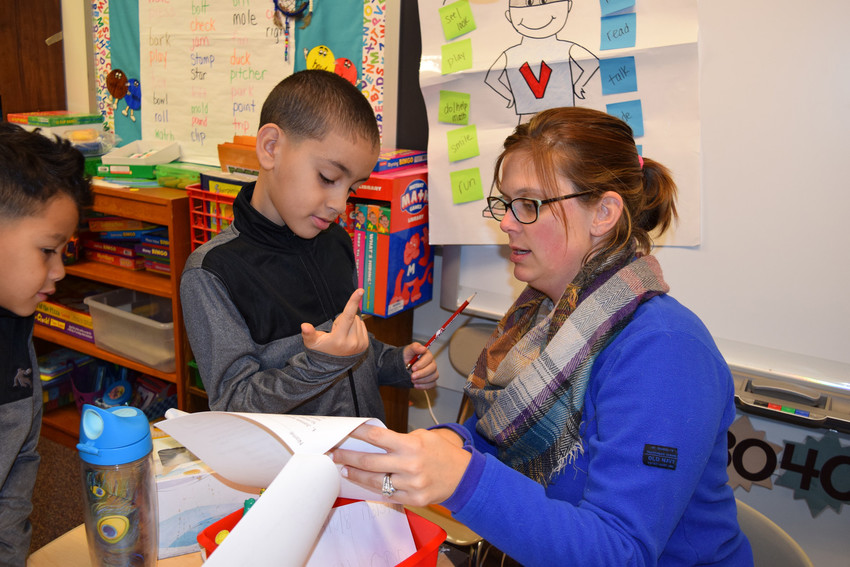 Middletown Area School District English Language Development teacher Ashley Sabitsky works with second-grade student Luis Alvarado Torres at Fink Elementary School on Dec. 15.