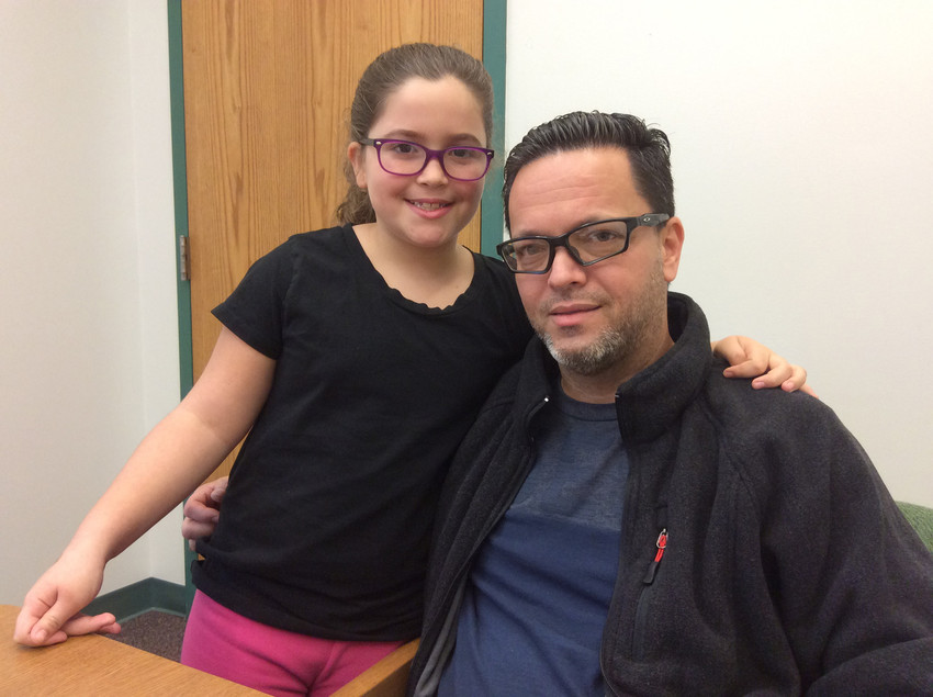 Ilian Veliz Lugo and her father Manuel Lugo share a hug at Fink Elementary School in Middletown.